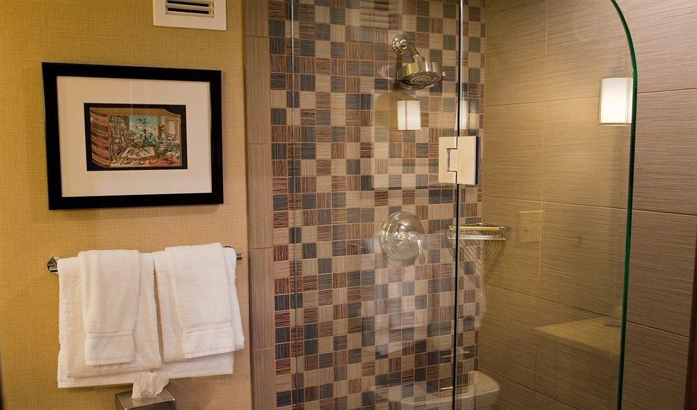 bathroom property shower plumbing fixture flooring tile home sink tiled