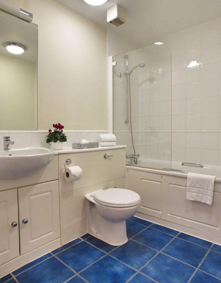 bathroom property flooring sink toilet home plumbing fixture tile tub tiled