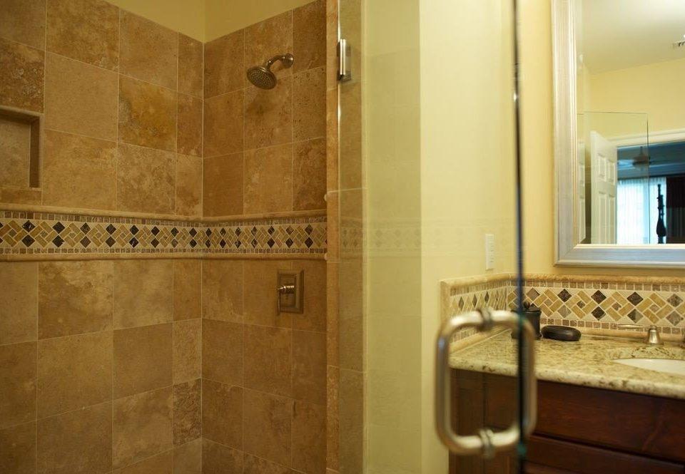 bathroom property sink scene flooring home plumbing fixture tile toilet tan