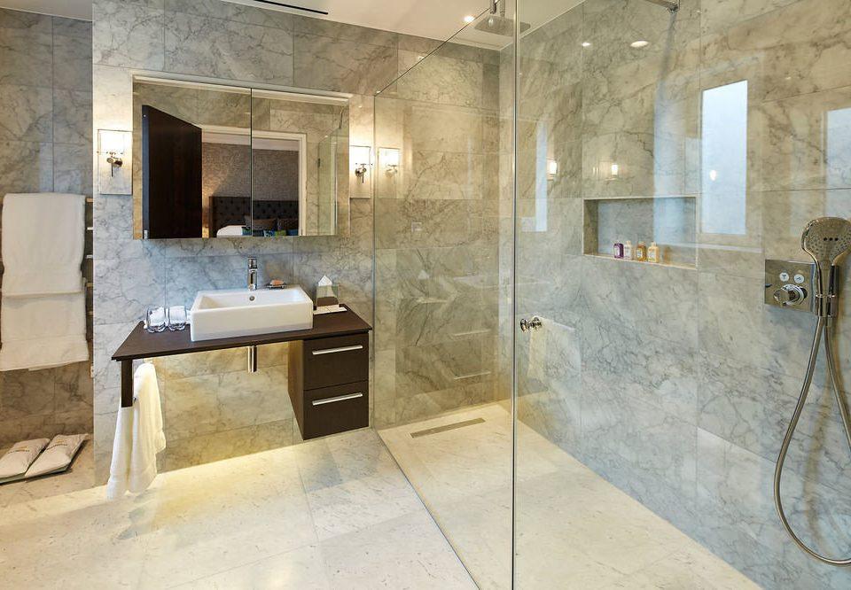 bathroom property flooring tile plumbing fixture home stone tub tiled