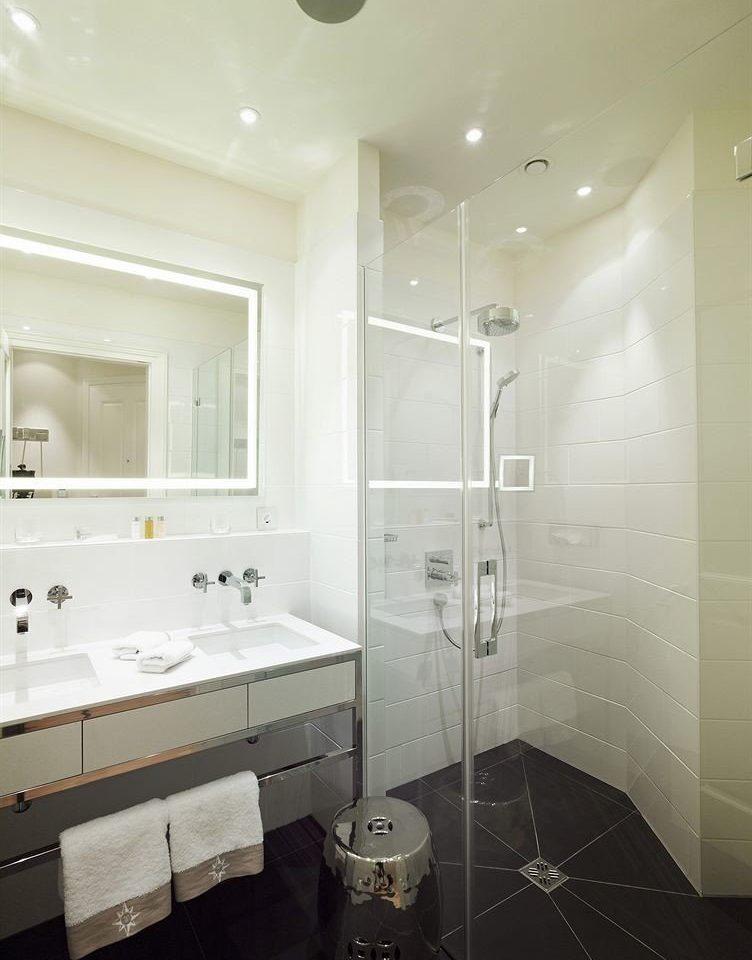 bathroom property white sink home toilet plumbing fixture flooring tile tiled