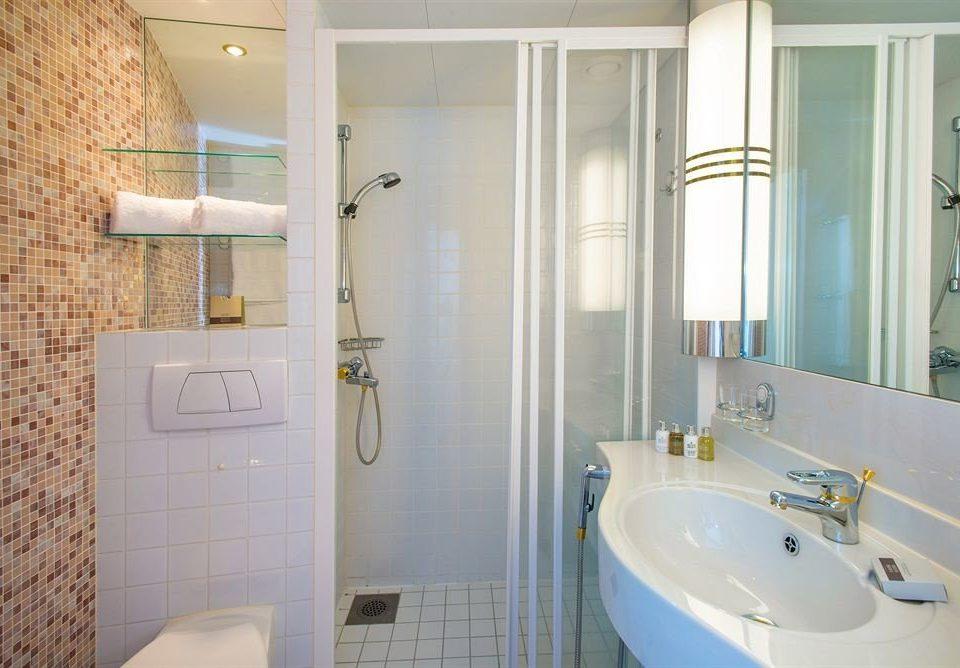 bathroom sink property toilet white home plumbing fixture flooring tile tiled tan