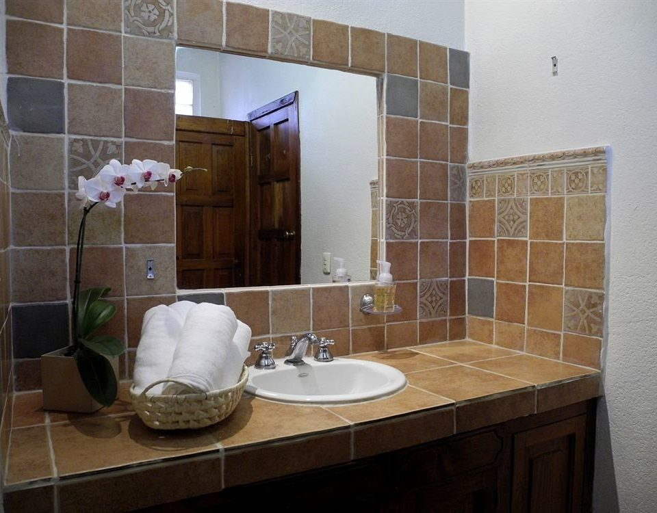 bathroom property sink plumbing fixture tile home flooring tiled tan