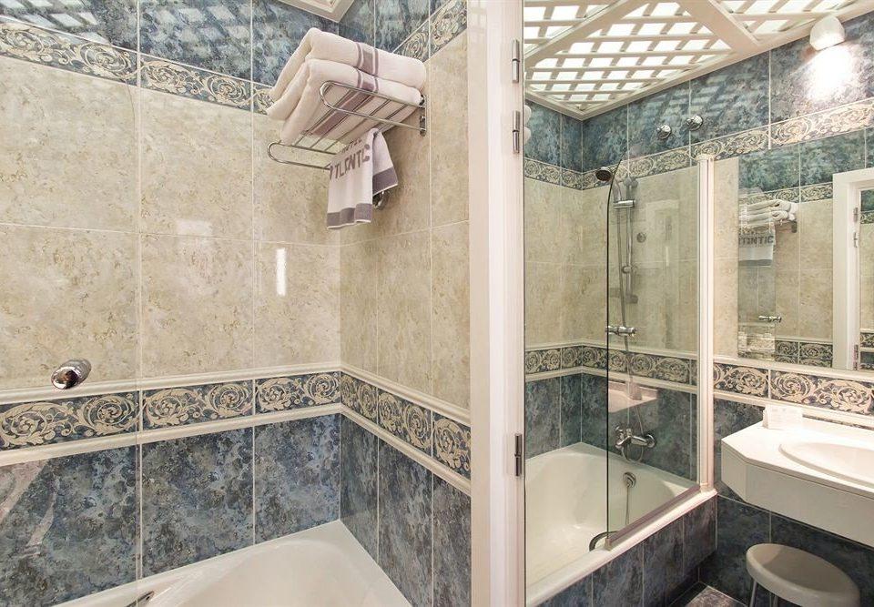 bathroom sink property scene tile home flooring plumbing fixture tiled tan