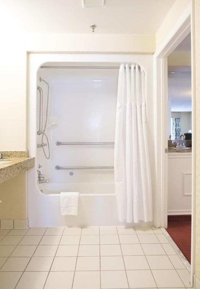 property white bathroom plumbing fixture home flooring tiled tile