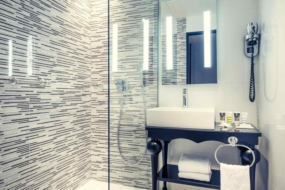 bathroom property flooring white tile plumbing fixture home