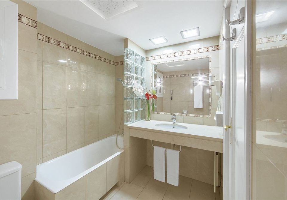 bathroom property home flooring toilet tiled tan