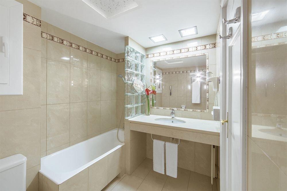 bathroom property home flooring toilet tiled tan
