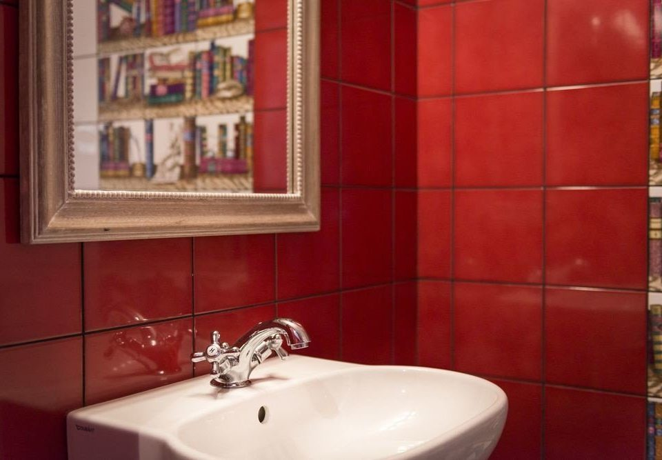 bathroom red property sink home flooring toilet tiled