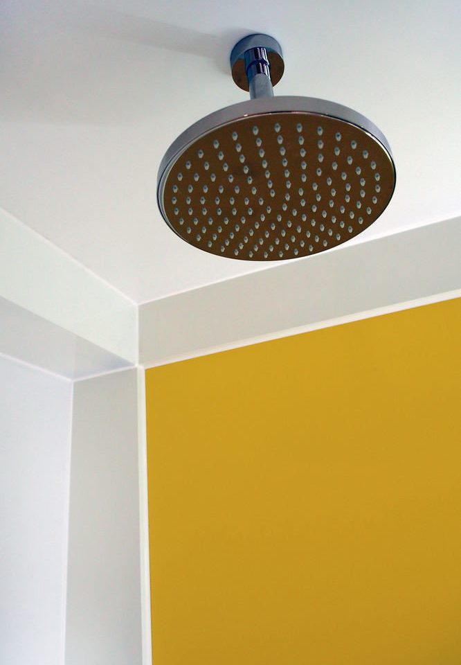 yellow sink plumbing fixture lighting flooring bathroom