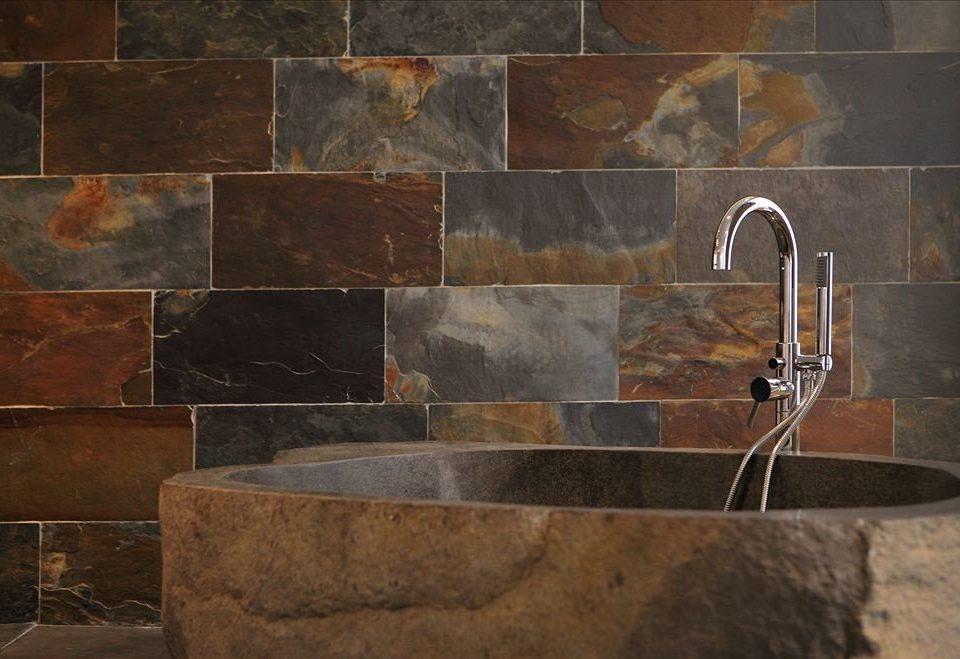 plumbing fixture sink tile bathroom flooring material stone