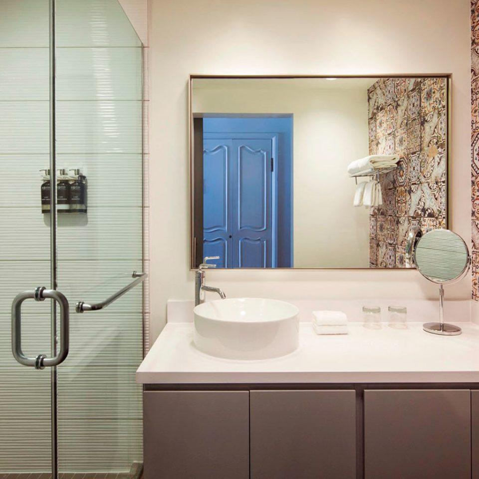 bathroom property mirror sink flooring toilet plumbing fixture tile tiled