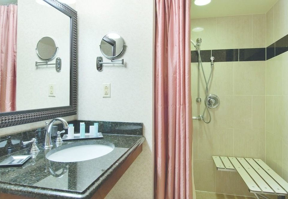 bathroom sink mirror property scene plumbing fixture flooring
