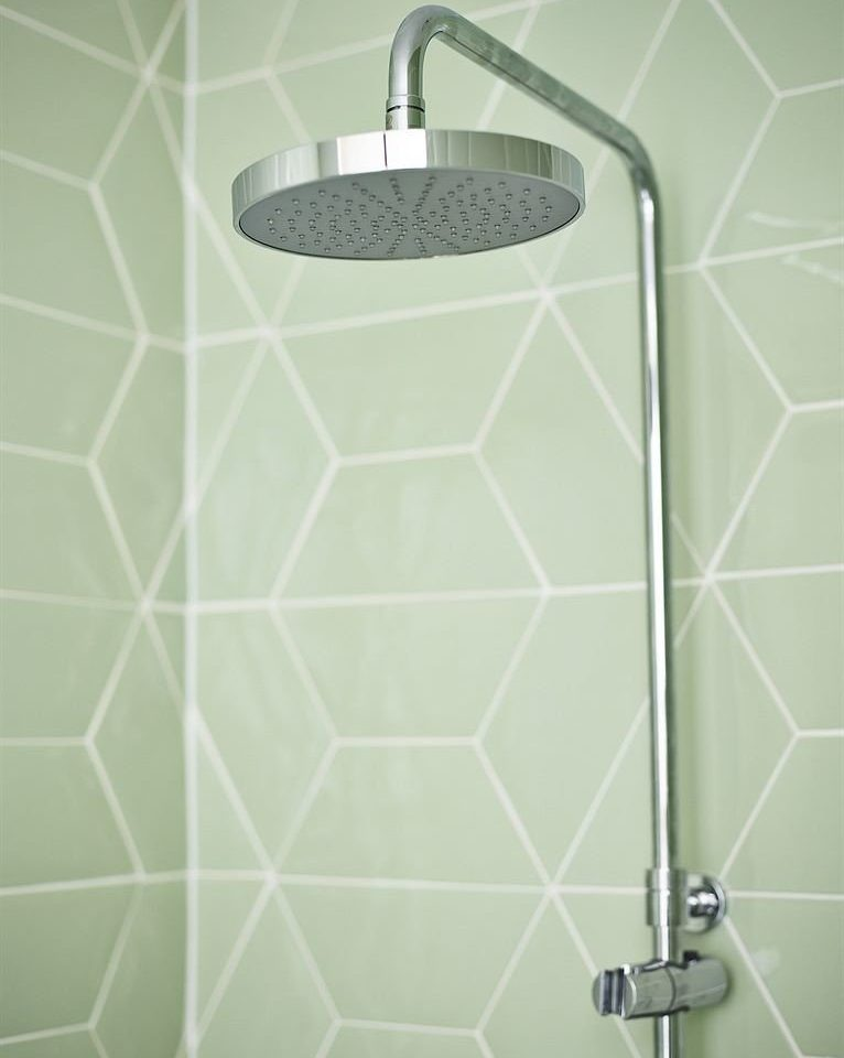 tile flooring plumbing fixture tiled shower net toilet sink bathroom