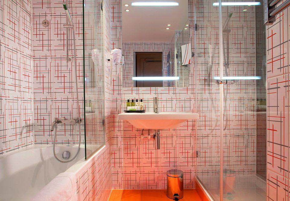 bathroom property toilet plumbing fixture flooring orange tiled tile