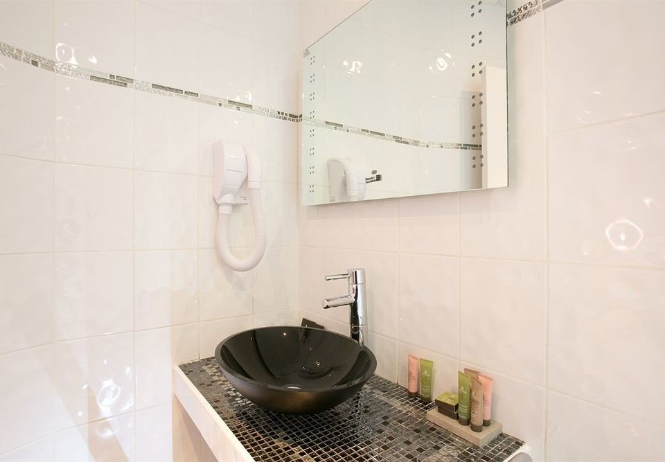 bathroom property flooring tile plumbing fixture toilet tiled