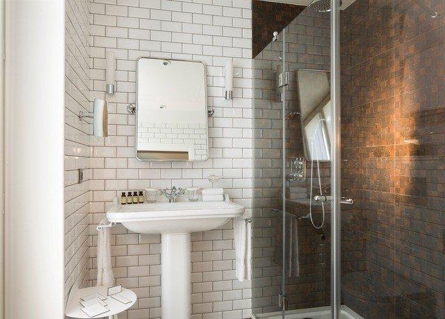 bathroom property plumbing fixture tile tiled sink flooring toilet public