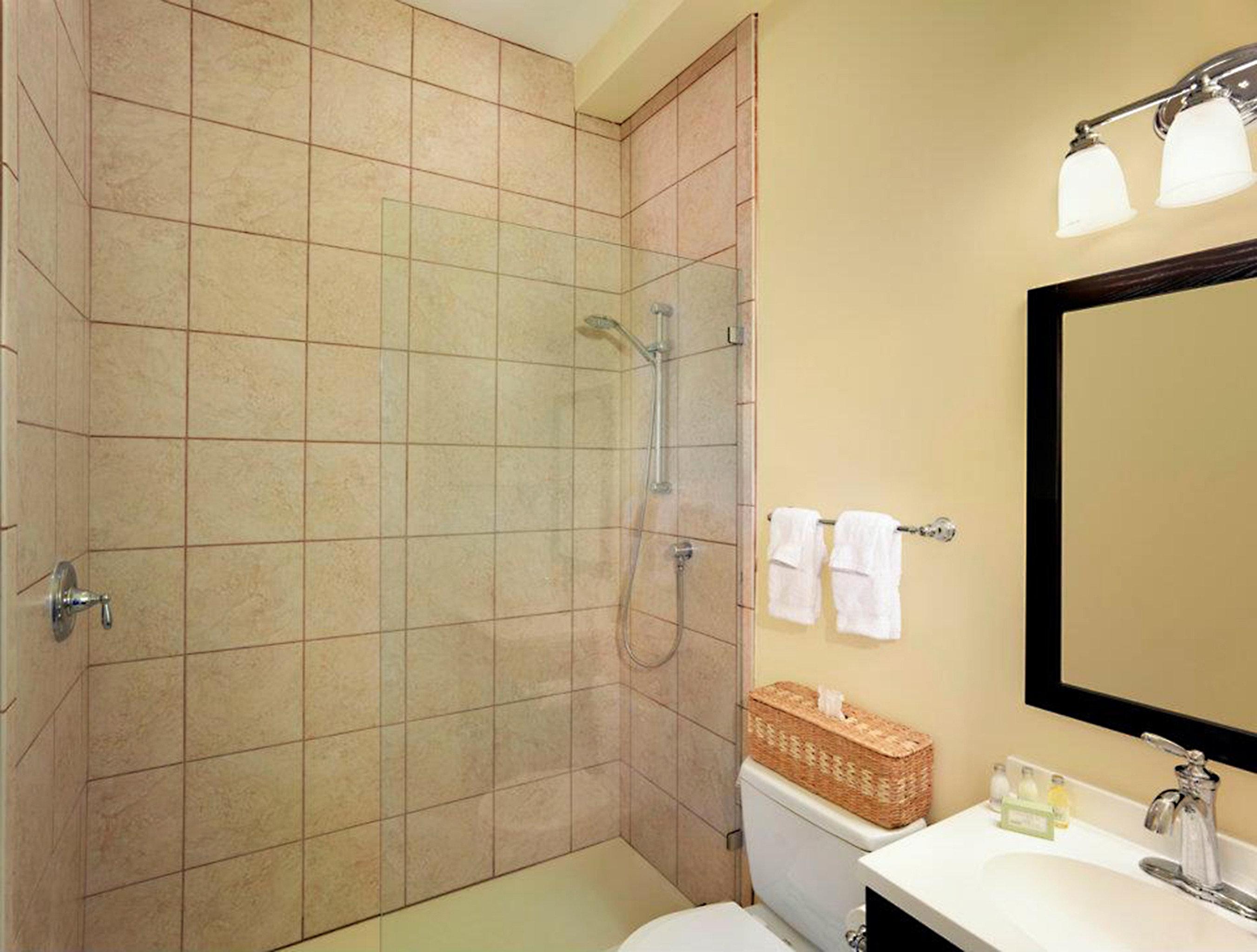 bathroom property sink plumbing fixture toilet flooring tile tiled