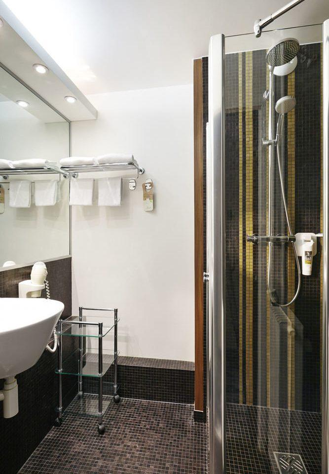 bathroom property plumbing fixture flooring tiled