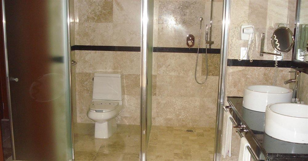 bathroom property plumbing fixture toilet public toilet flooring