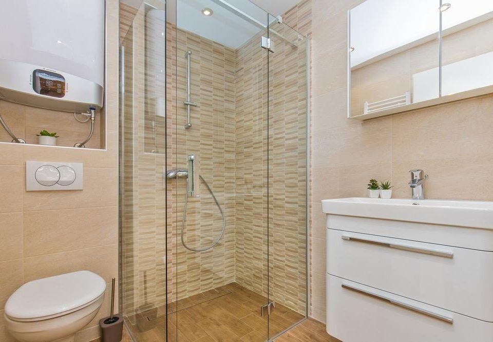 bathroom property scene plumbing fixture toilet flooring sink tile