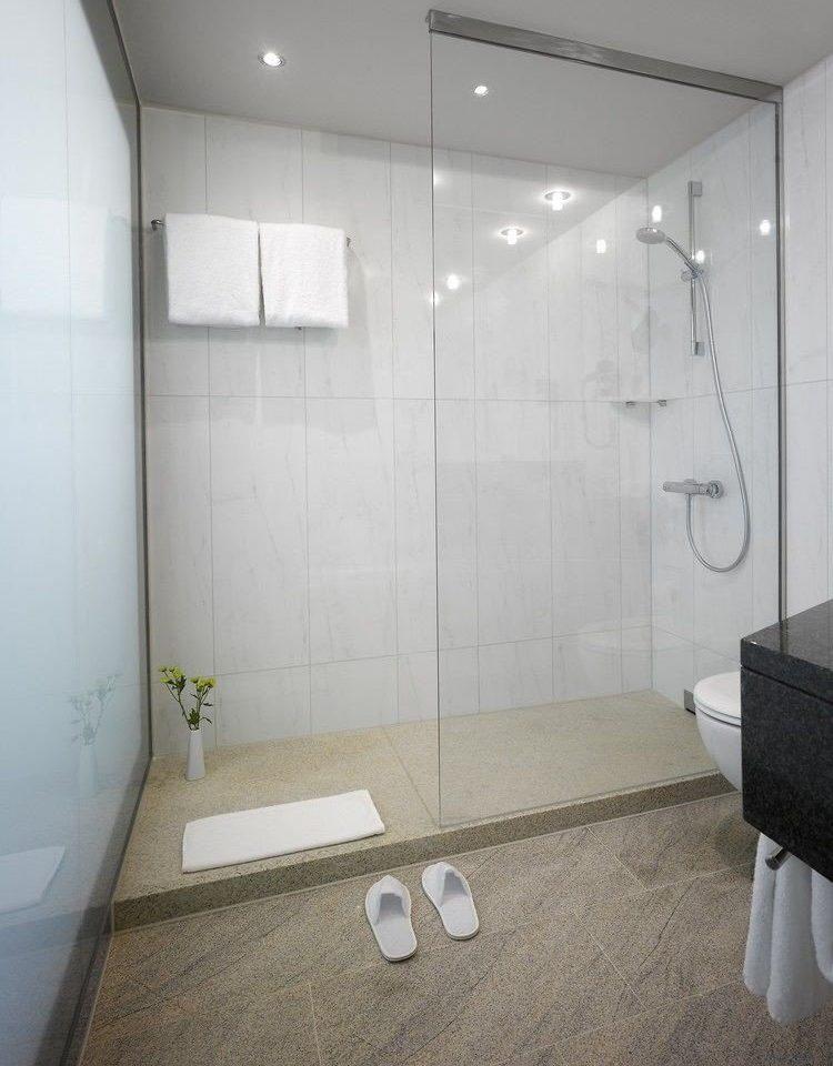 property bathroom plumbing fixture flooring toilet tiled tile