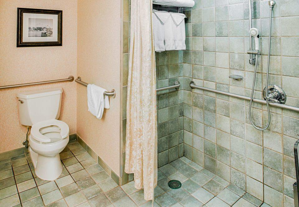 bathroom toilet property plumbing fixture flooring tile public toilet sink tan