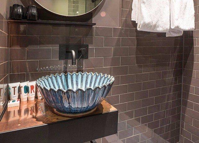 property tile flooring toilet plumbing fixture bathroom tiled
