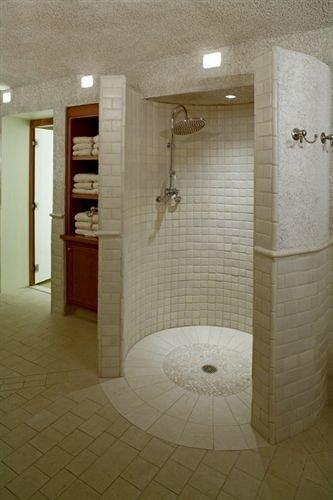 bathroom property plumbing fixture public toilet flooring tiled tile