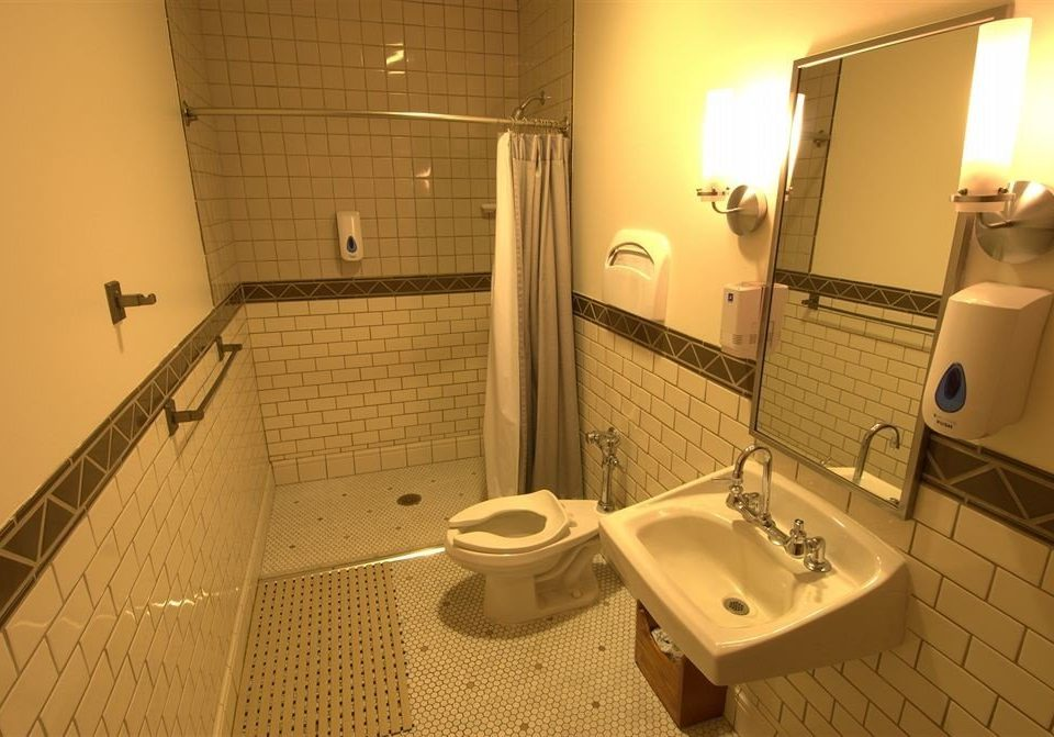 bathroom property toilet swimming pool sink white plumbing fixture flooring tile tiled trash