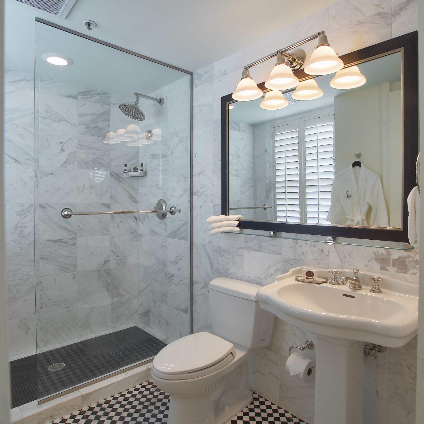 bathroom property toilet sink plumbing fixture flooring tile tiled