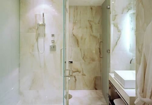 bathroom property plumbing fixture white shower flooring