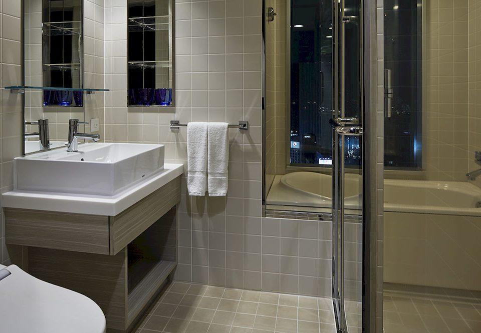 bathroom toilet plumbing fixture flooring tile sink public toilet public tiled