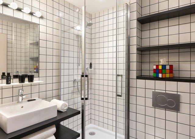 bathroom toilet plumbing fixture tile flooring public tiled