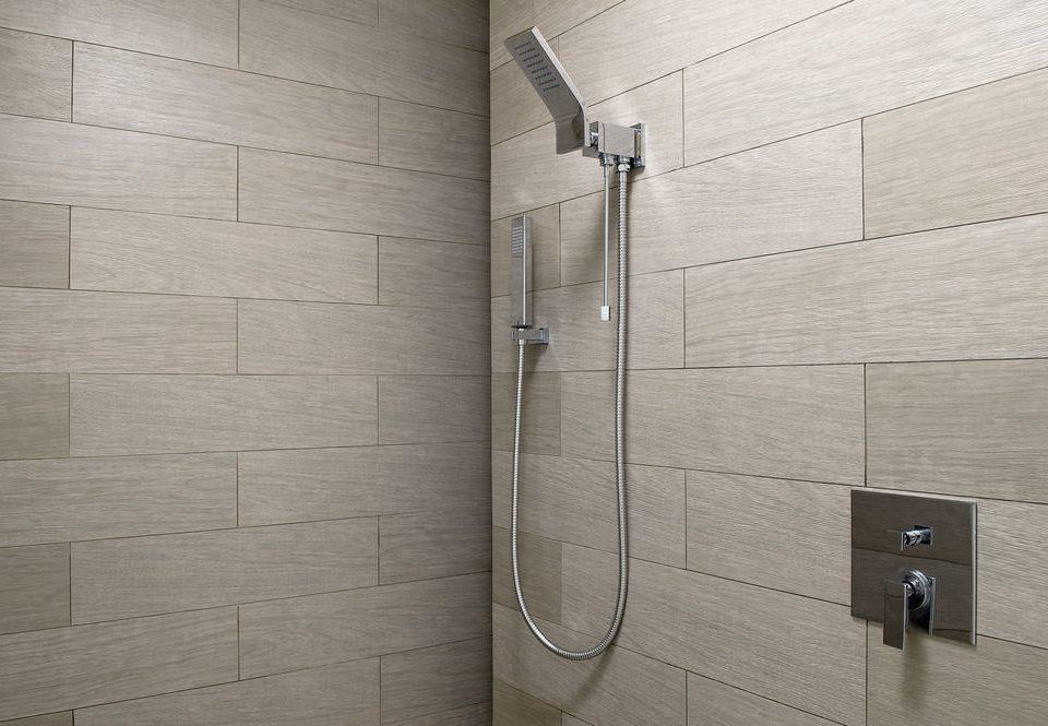 bathroom tile plumbing fixture flooring shower public toilet tiled
