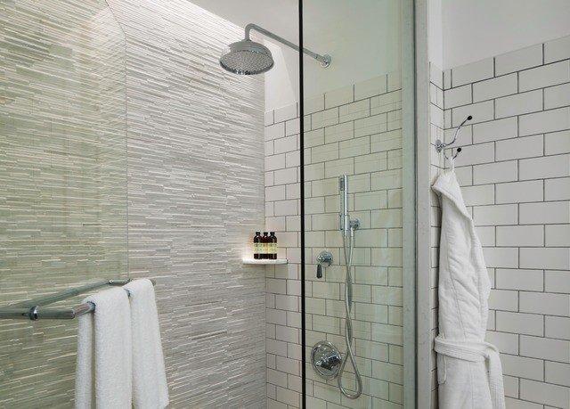bathroom plumbing fixture tile white flooring shower rack tiled