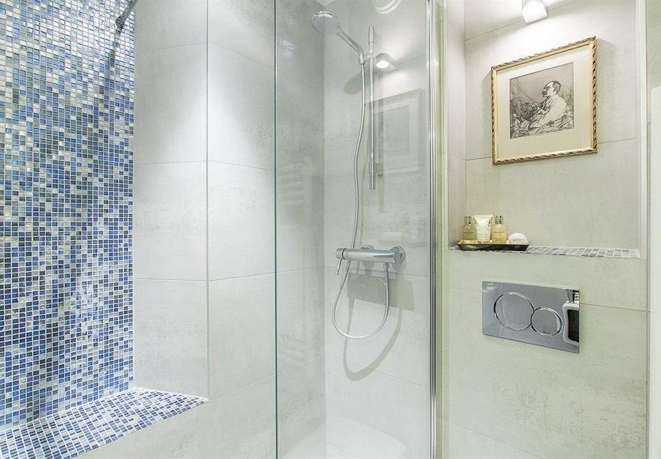 bathroom toilet scene plumbing fixture shower flooring tile tiled
