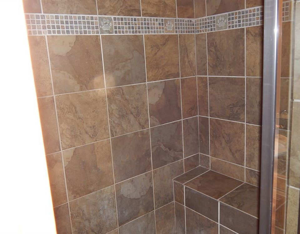 bathroom tile flooring scene plumbing fixture shower tiled stall tan