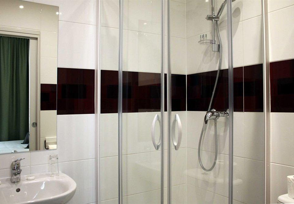 bathroom scene shower sink plumbing fixture flooring vessel tiled tile