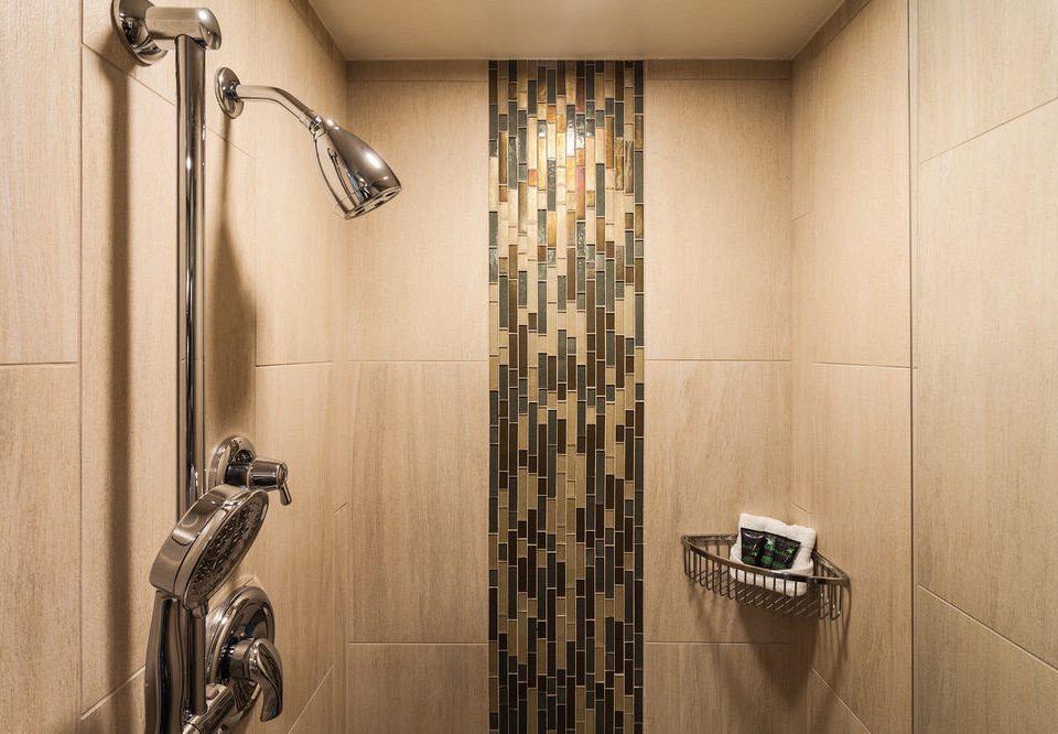 bathroom plumbing fixture flooring toilet tiled tile