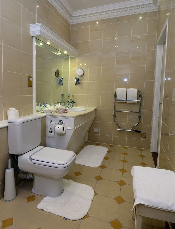 bathroom property sink public toilet flooring toilet tile tiled