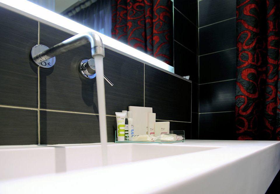 lighting plumbing fixture bathroom glass tiled