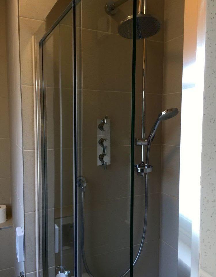 bathroom scene shower plumbing fixture glass stall tiled