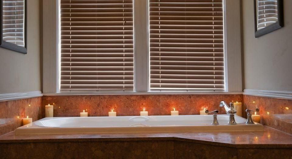 bathroom sink hardwood material window treatment orange
