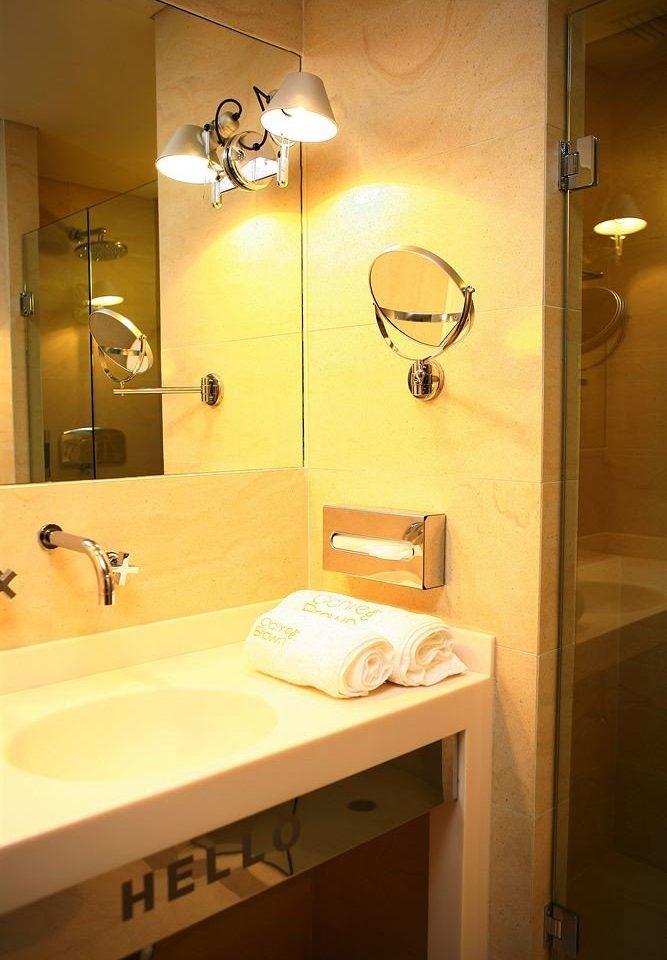 bathroom mirror sink toilet house home lighting plumbing fixture towel light rack