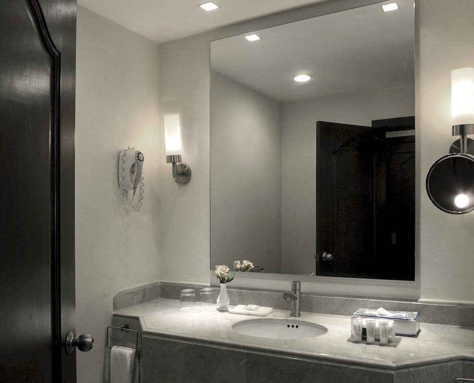 bathroom mirror sink property home lighting vanity light toilet