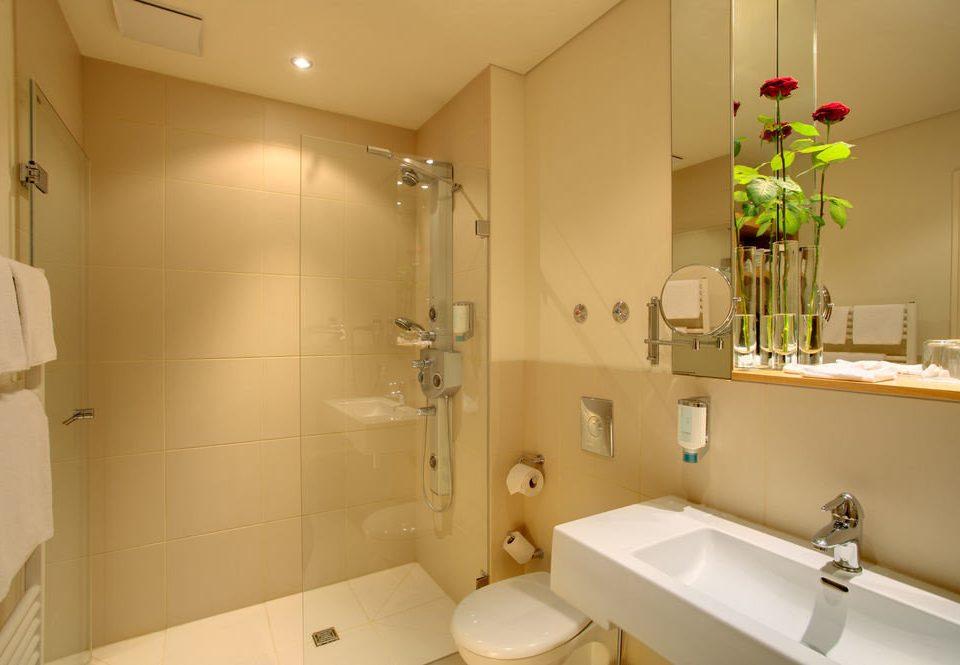 bathroom property sink mirror toilet home light plumbing fixture