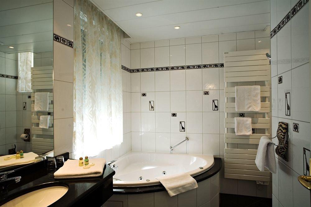 bathroom sink mirror property lighting home plumbing fixture toilet tile