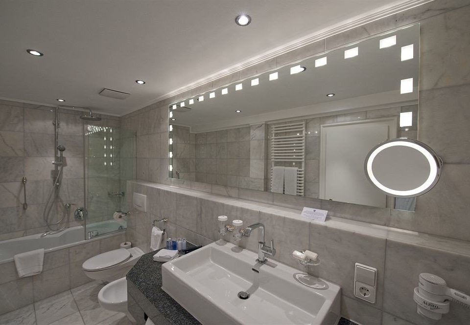 bathroom mirror sink property toilet lighting home tile tiled