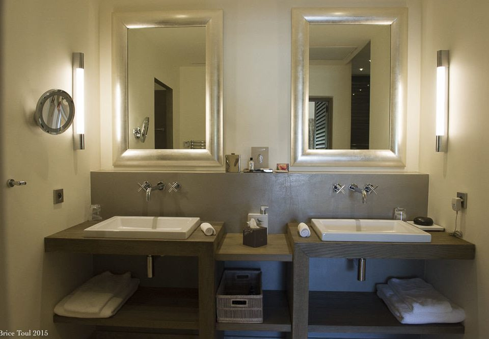 bathroom mirror sink property home lighting plumbing fixture
